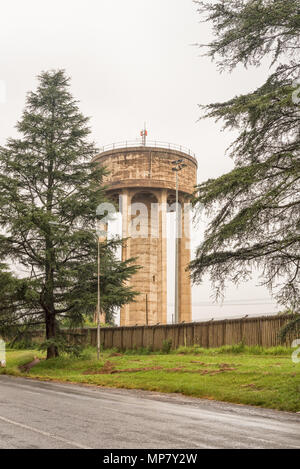 A concrete water reservoir tower in Howick in the Kwazulu-Natal Midlands Meander of South Africa - Stock Photo