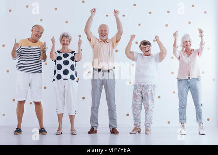 Positive elderly people have fun together. Happy life in retirement concept - Stock Photo