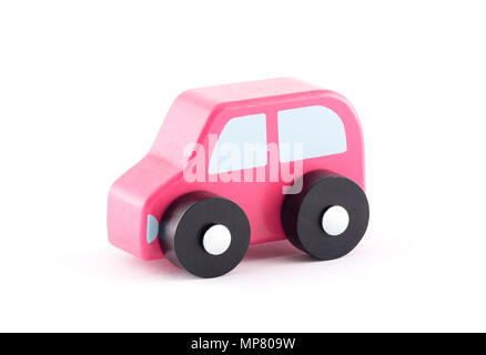 Small wooden toy car on white background with clipping path - Stock Photo