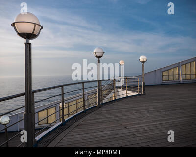Lamp posts on a deserted ferry deck in late afternoon - Stock Photo