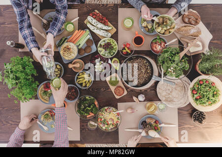 Verious veg dishes lying on rustic table, top view - Stock Photo