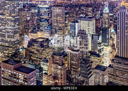 Aerial view of Manhattan skyscrapers by night - Stock Photo