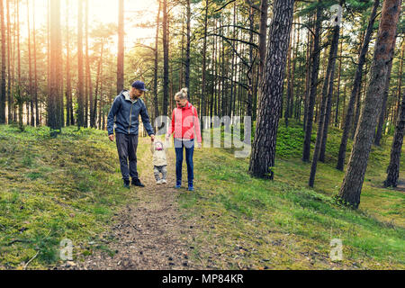 family walk in the forest - Stock Photo