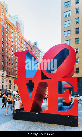 New York, USA - May 06, 2015: Love sculpture by American artist Robert Indiana, New York. The famous monument is located on 6th Avenue. - Stock Photo