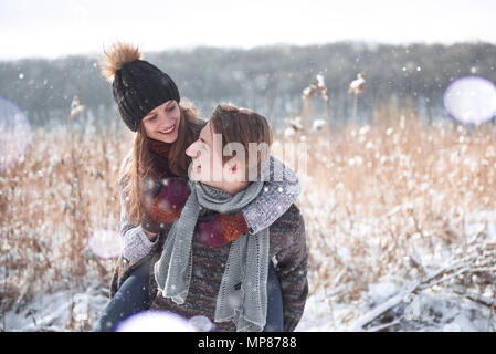 christmas happy couple in love embrace in snowy winter cold forest, copy space, new year party celebration, holiday and vacation, travel, love and relations - Stock Photo
