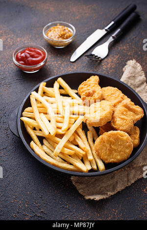 French fries and chicken nuggets  - Stock Photo