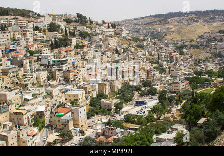 A view across the Kidron Valley to the densely built up hills of Jerusalem from the steps to Hezekiah's Tunnel in the city of Jerusalem in Israel - Stock Photo