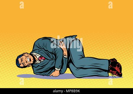 man lies hurts stomach - Stock Photo