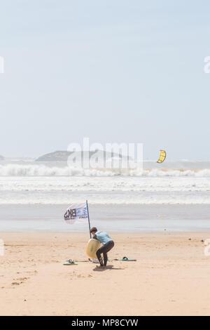 Kite surfing along Essaouira beach. - Stock Photo