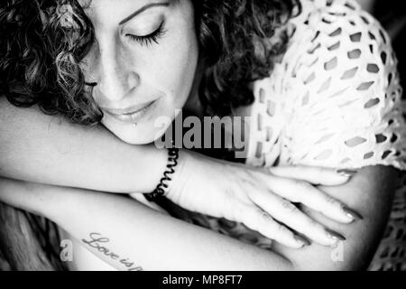 lonely sad girl woman portrait in black and white. fine art picture with beautiful model with closed eyes. - Stock Photo