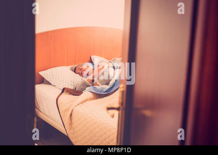 adult aged couple sleep at the bedroom at home, indoor daily scene for sweet love forever. retro look filter. hidden scene. sweetness and elderly - Stock Photo