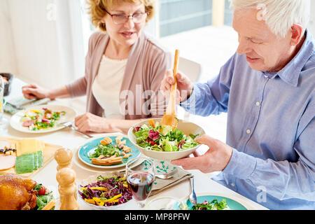 Grandparents Enjoying Food at Family Dinner - Stock Photo