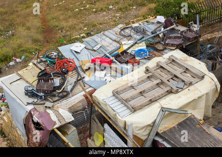 Waste thoughtlessly piled upon rooftops  of Arab homes in the city of Jerusalem and clearly visible to tourists from the rooftop of the historic Herod - Stock Photo