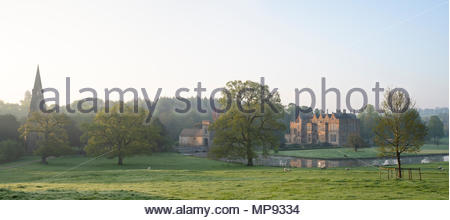 Broughton castle in spring at sunrise. Broughton, Banbury, Oxfordshire, England. Panoramic - Stock Photo