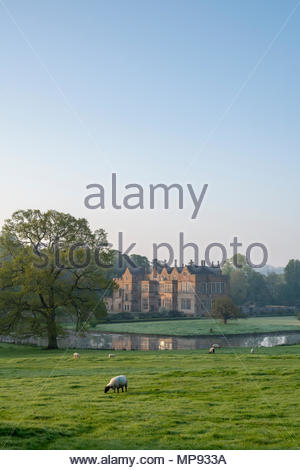 Broughton castle in spring at sunrise. Broughton, Banbury, Oxfordshire, England - Stock Photo