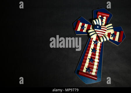Cross with American Flag on Black Background - Stock Photo