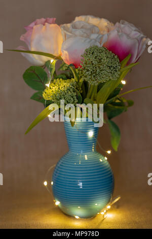 Home Decor Blue Flowers In The Vase On The Table Stock Photo