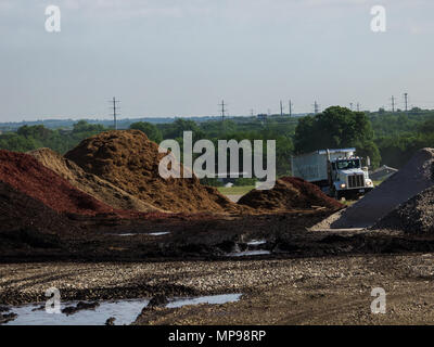 In the DFW metroplex one of the fastest growing areas in the counry the landfills are filling up, housing and businesses are approaching. Is it safe and healthy to live next to a landfill? Photos at the Arlington landfill operated by Republic - Stock Photo