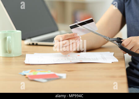 Close up of a woman hands destroying old credit cards - Stock Photo
