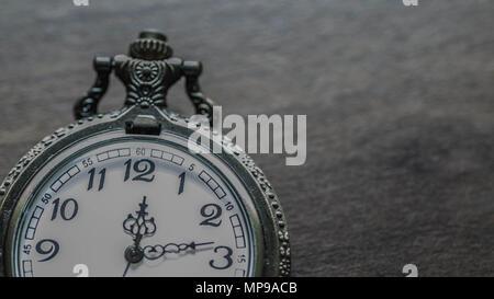 old vintage pocket watch showing time on wooden background