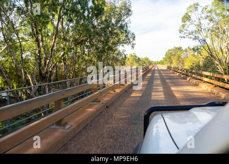 A four wheel drive vehicle with a bull bar crossing the Wilare Bridge over the Fitzroy River in the Kimberley, WA, Australia. - Stock Photo