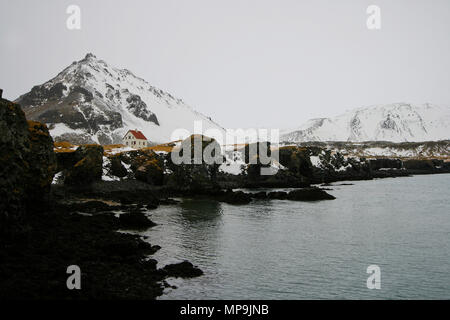 Solitary house in Iceland - Stock Photo