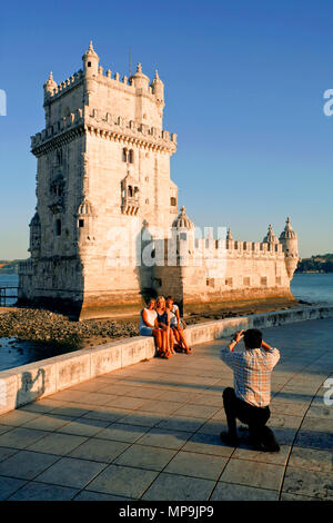Tourists posing for a photograph, Torre de Belém / Belém Tower / Torre de São Vicente / Tower of St Vincent, Belém, Lisbon, Portugal - Stock Photo