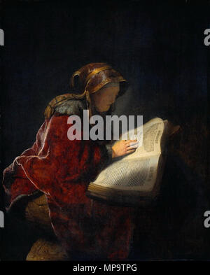 An Old Woman Reading, Probably the Prophetess Hannah   1631.   1051 Rembrandt prophet hannah - Stock Photo