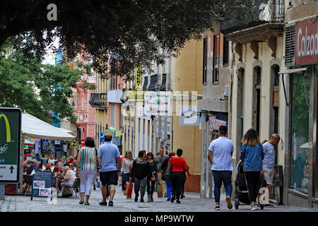 One of the main shopping streets on the Canary Island of Tenerife is thronged with locals and tourists alike on a Saturday afternoon in May - Stock Photo