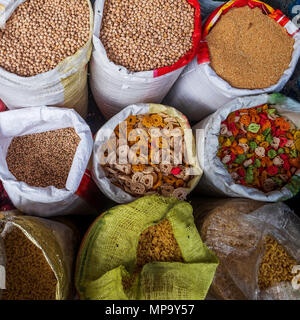 Various type of cereal grains chickpeas, pasta on asian market. - Stock Photo