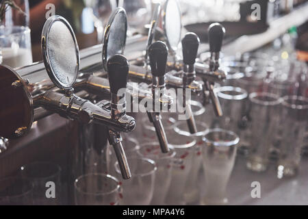 ready to pint of beer on a bar in a traditional style wooden pub - Stock Photo