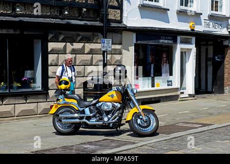 Man admiring Harley Davidson motorbike, St Ives, Cambridgeshire, England UK - Stock Photo