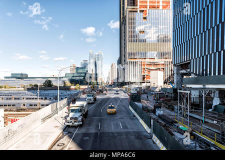 New York City, USA - October 30, 2017: View of the Hudson Yards train depot and building development from the High Line, an elevated urban park in NYC - Stock Photo