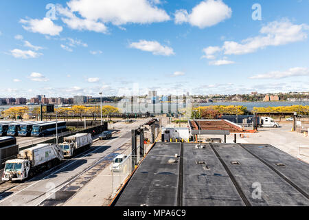 New York City, USA - October 30, 2017: View of Hudson River from highline, high line, urban in NYC with buses, people, in Chelsea West Side by Hudson  - Stock Photo