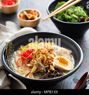 Spicy ramen bowl with noodles and chicken - Stock Photo
