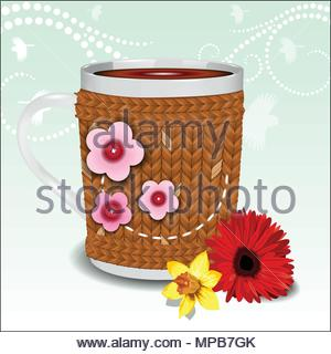 Cute cup in a sweater decorated with flowers - Stock Photo