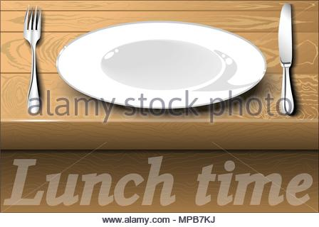 White plate with cutlery on a wooden dining table. Lunch time. - Stock Photo