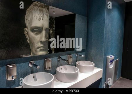 Modern men blue tailed toilet, restroom, Rinascente Department Store. Mosaic portrait of roman young man, viewed in opposing mirror. Rome, Italy - Stock Photo