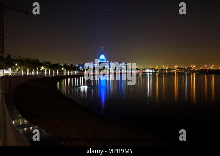 Dubai, United Arab Emirates - May 21, 2018: Dubai Silicon Oasis Headquarters Building with Lake view at night, Established in 2014 a free zone owned b - Stock Photo