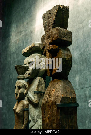 Exhibit in Museum of Pre-Columbiam Art, Santiago, Chile. Wooden figures with top knots, called Chemamulles, found at Andean culture Mapuche cemeteries - Stock Photo