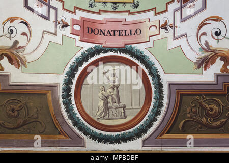 Italian Renaissance sculptor Donatello working on the bronze statue Judith and Holofernes depicted in the ceiling fresco in the Vasari Corridor in the Uffizi Gallery (Galleria degli Uffizi) in Florence, Tuscany, Italy. - Stock Photo