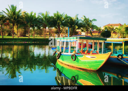 Boats at the Embankment of Thu Bon River in Hoi An, Vietnam - Stock Photo