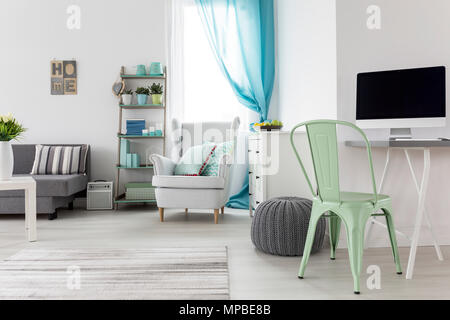 Spacious bright room with cosy space to work - Stock Photo