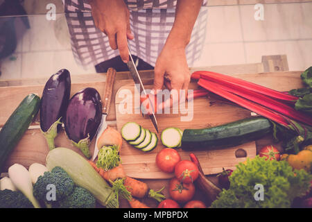 Closeup of Human hands cooking food, vegetables salad in kitchen. Preparing fresh meal in the kitchen. Healhty lifestyle concept at home eating raw in - Stock Photo