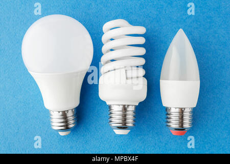 different types of energy-saving lamps on a blue background. Close-up, top view - Stock Photo