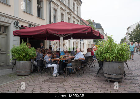 31st August 2017, Potsdam, GERMANY. Cafe views on the  Brandenburger Str. Tables Chairs Red Umbrella, potted plant Large; Potted, Ps, © Peter SPURRIER - Stock Photo