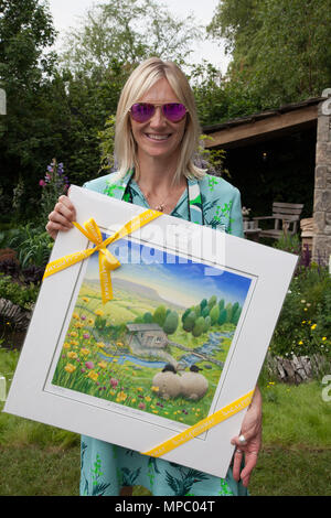 Chelsea, London, UK. 21st May, 2018. Jo Wiley on the Welcome to Yorkshire garden at Chelsea Flower Show 2018, designed by Mark Gregory for Landformconsultants.co.uk Credit: Jenny Lilly/Alamy Live News - Stock Photo