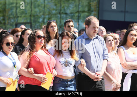 Manchester, UK. 22nd May 2018. People gather in Cathedral Gardens to watch a big screen of the Memorial service taking place inside the Cathedral for the 1st  memorial of the arena bomb, Manchester, 22nd May, 2018 (C)Barbara Cook/Alamy Live News - Stock Photo