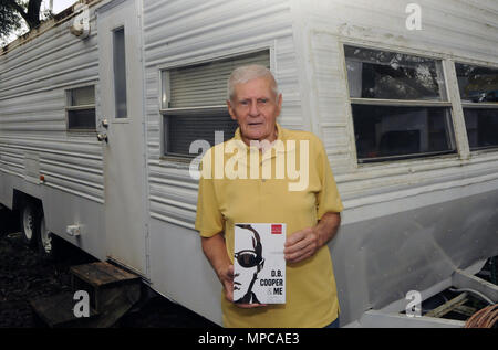 Florida, USA. 22nd May, 2018. Carl Laurin poses on May 22, 2018 by the 'research' trailer next to his home in DeLand, Florida where he wrote his book 'D.B. Cooper & Me: A Criminal, a Spy, My Best Friend' which was released on May 17, 2018. The book chronicles the confessions of Laurin's longtime friend, Walter R. Reca, who, around 2008, related to Laurin that he committed the infamous 1971 hijacking of a Northwest Orient flight from Portland to Seattle. Credit: Paul Hennessy/Alamy Live News - Stock Photo
