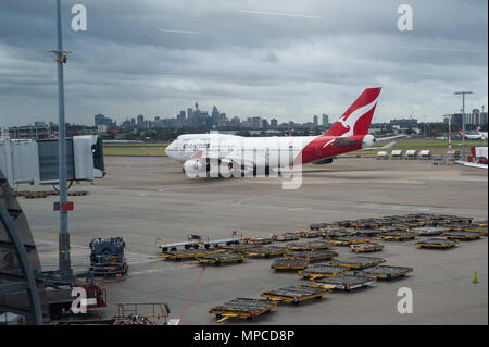 13.05.2018, Sydney, New South Wales, Australia - A Boeing 747-400 passenger plane of the Australian airline Qantas is seen taxiing at Sydney airport. - Stock Photo